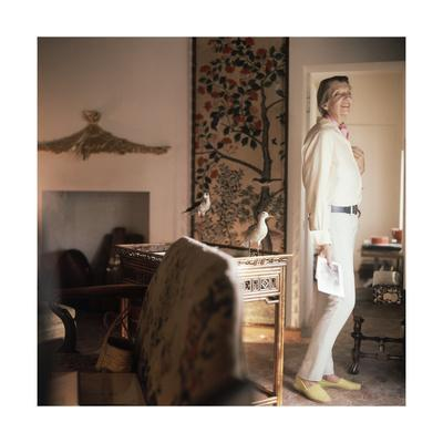 Outtake: Pauline De Rotherchild Stands in a Doorframe of Her in Her Home