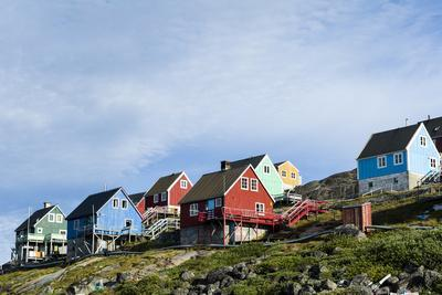 Colorful Fishing Houses Perched on the Rocky Shoreline of an Arctic Island
