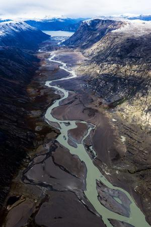 A Winding River Snakes its Way Through a Highland Tundra Valley to a Fiord