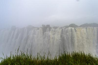 A Rainstorm Falls over the Cascading Victoria Falls Already in Flood