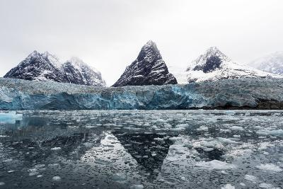 The Sheer Fracture Zone of a Glacier Sandwiched Between Alpine Peaks in a Fjord