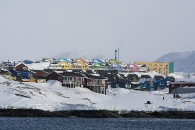 Colorful Houses by the Sea, in a Snowy Landscape