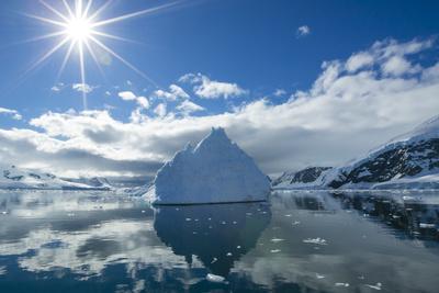 Reflections of Icebergs on Water in Niko Harbor, Antarctica