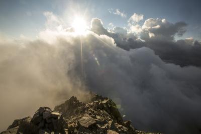 Sunlight Streams Through Clouds onto the Peak of Cima D'Asta