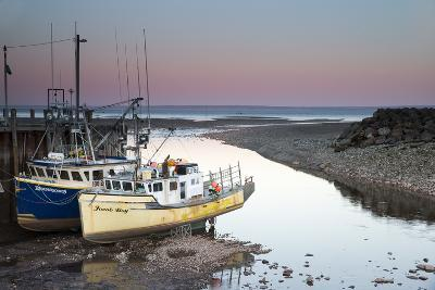 A Couple of Fishing Boats on Dry Land at Low Tide