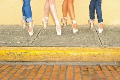 Professional Ballerinas Wearing Ballet Shoes with Jeans