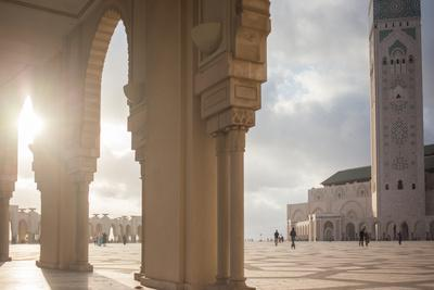 The Sun Setting Between Archways of Hassan Ii Mosque, Casablanca, Morocco