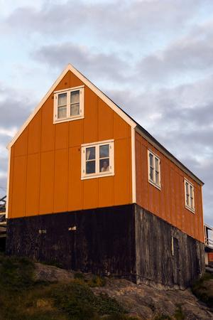 A Bright Orange Cottage in a Fishing Village on an Island