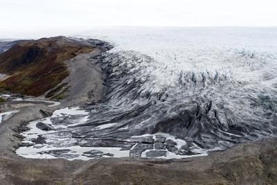A River Skirts a Pile of Rock, Sediment and Silt Debris Deposited by the Leading Edge of a Glacier