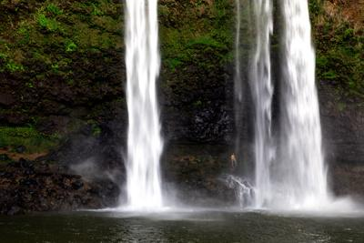 A Man Stands under Wailua Falls