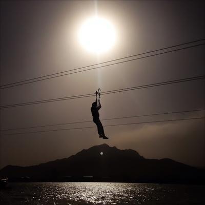 A Man Travels Down a Hipline Above a Lake Outside Beijing