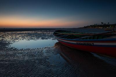 A Lone Fishing Boat at Dusk on Jericoacoara Beach