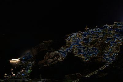 A Color Inverted Composite Image of Santorini Island at Night