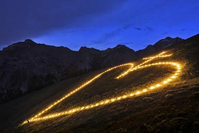 The Building and Lighting of a Sacred Heart Fire on Elferspitze Mountain in the Stubai Valley