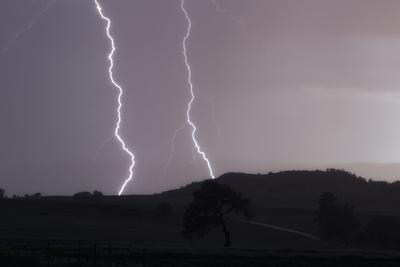 A Cloud-To-Ground Lightning Strike in a Mountainous Valley