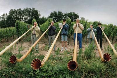 Men from Surrounding Villages Practicing on their Alpenhorns Along a Vineyard Road