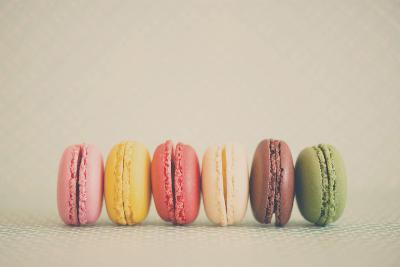 A Rainbow Selection of Sweet French Macarons Sitting in a Row.