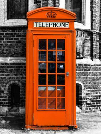 Red Phone Booth in London painted Orange - City of London - UK - England - United Kingdom - Europe