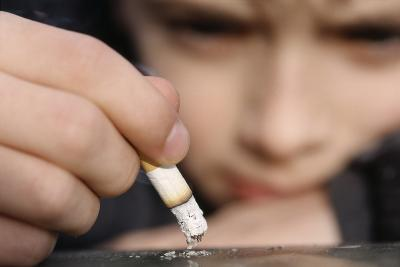 Boy Playing with a Cigarette