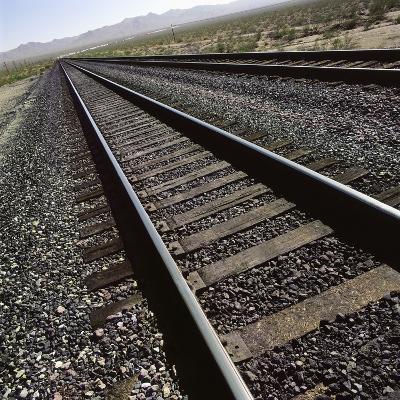 Railroad tracks running through desert setting