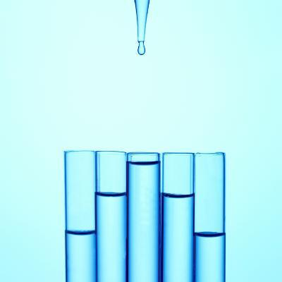 A Glass Pipette Drops Water in to a Series of Staggered Test Tubes or Vials
