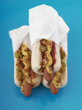 Three hot dogs in buns
