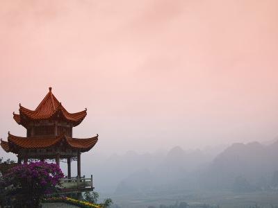 Temple Pavilion with Karst Hills in Mist