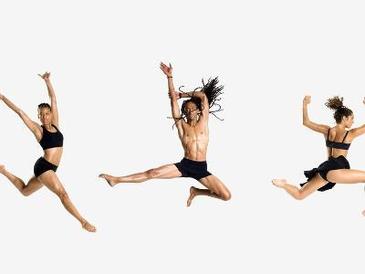 Three dancers jumping