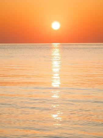 Sunlight Reflecting on Ocean at Sunset