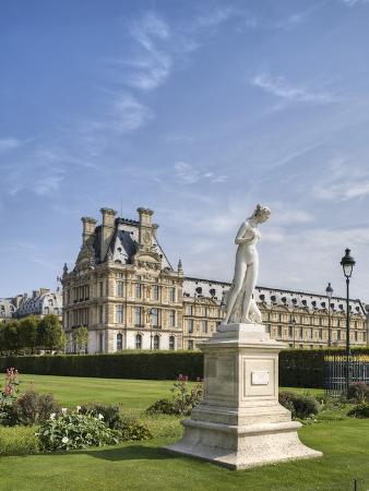 Statue of Nymphe and Louvre Museum, Paris