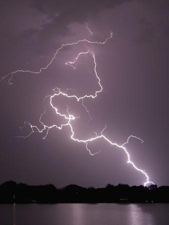 Lightning Striking Ground Near Residential Lake