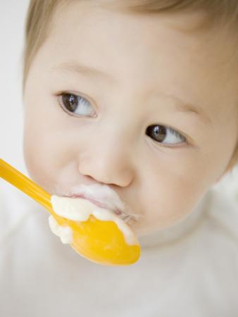 Boy having ice cream with spoon