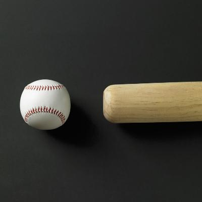 Directly-above view of a bat and a ball in a row