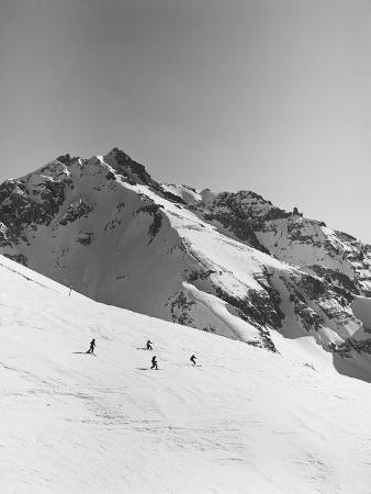 Skiers Skiing Down Mountain