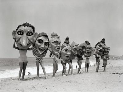 Women Holding Giant Masks