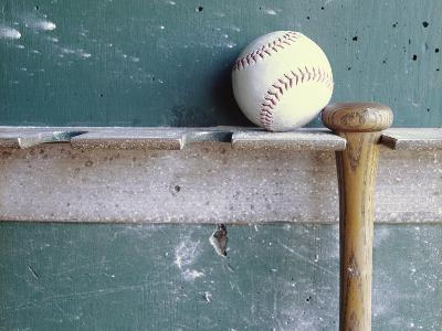 Baseball and Bat on Rack