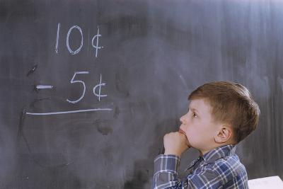 Boy Working on Subtraction Problem