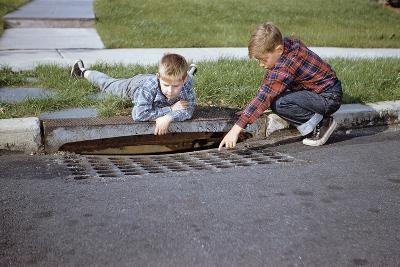 Boys Looking into Grate