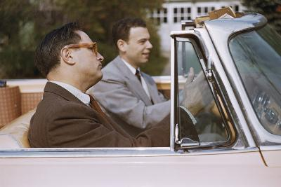 Businessmen Carpooling to Work in Convertible