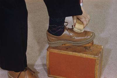 Man Buffing His Shoes
