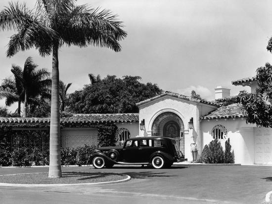 classic tropical island home decor coastal living.htm 1930s car in circular driveway of tropical stucco spanish style  circular driveway of tropical stucco