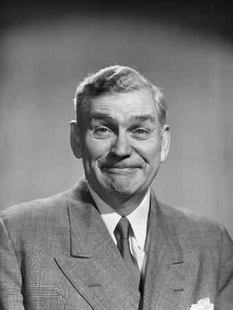 1950s Mature Middle Aged Man Smiling Business Suit Tie Happy Amused Funny Face Expression