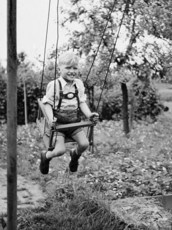 Four Year Old Boy on a Swing, Ca. 1950