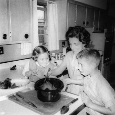 Mom Prepares Dinner with the Kids Watching, Ca. 1962