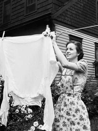 Woman Hanging Laundry Out to Dry