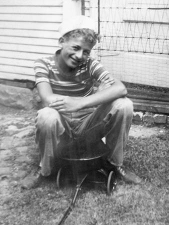 Boy Sitting a Very Small Wagon, Ca. 1938
