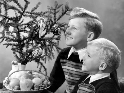 Two Brothers Look at a Candle on a Christmas Tree in Germany, Ca. 1950