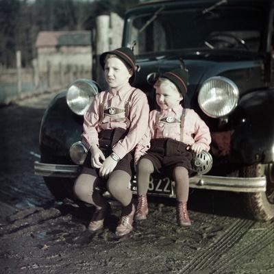 Two Brothers Sit on the Bumper of the Family Mercedes Benz in Germany, Ca. 1949