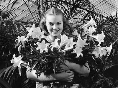 Young Woman with Arms Full of Easter Lillies