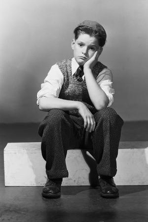 Boy in Dejected Pose